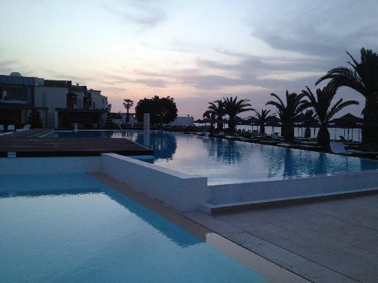 SENTIDO Ixian Grand: sunset over the pools
