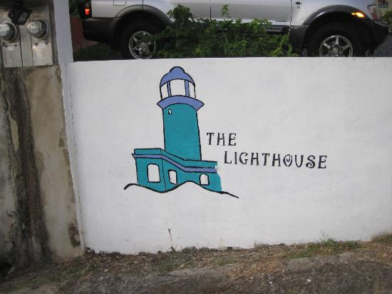 "The Lighthouse : ""Sign"" on side of wall."
