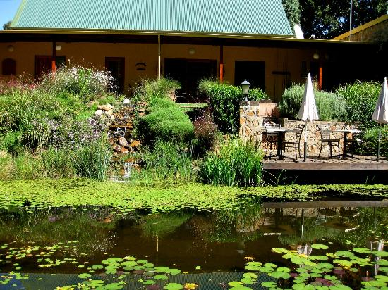 Stonecutters Lodge: The deck over the pond in front of Stone Manor