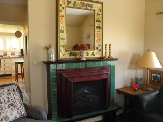 Enchanted Cottage: I love this mirror over the fireplace!
