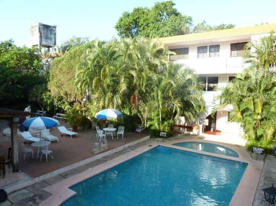 tropical courtyard with swimming pool in hotel San Clemente