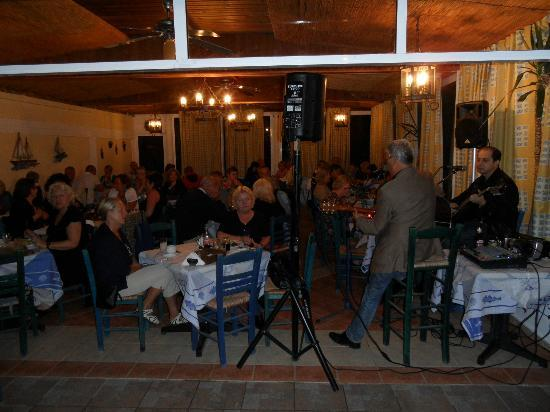 Pelagos Live Music Restaurant : A rainy night so the musicans had to move in under the roof