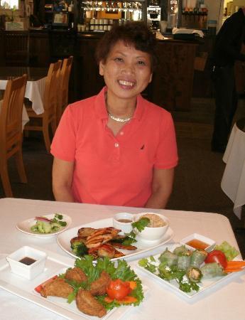 Rin's Thai Restaurant: Rin's owner Yupa Garrett with Grilled Salmon, Fresh Spring Rolls & Puffy's appetizer.
