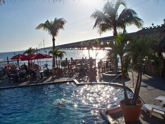 Sunset Bar & Grill : bar by the pool and 7 mile bridge in background