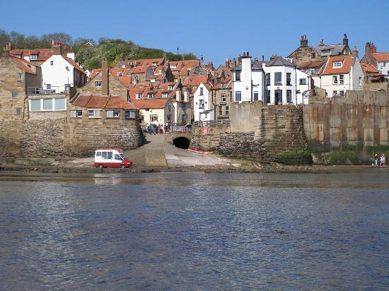 Smugglers Bistro and Accommodation: General view of Robin Hoods Bay from the beach (establishment is centre frame)