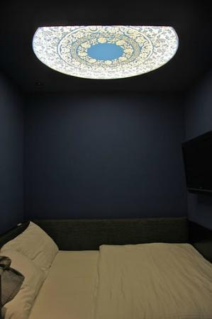 The Porcelain Hotel: Room = bed (turn around for bathroom) and thats it :)