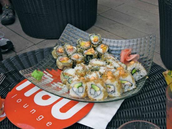 NAU Lounge: Three sushi rolls on one platter. The middle had cocnut sprinkled on top