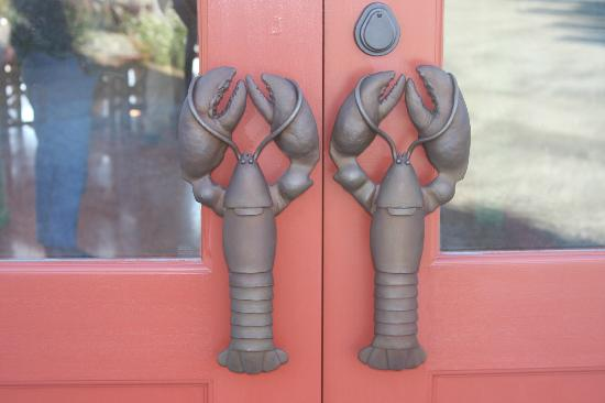 """Oliver's at Cozy Harbor: Entrance to restaurant, specially made lobster """"doors"""""""