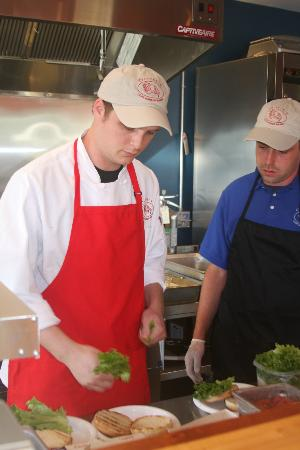 Oliver's at Cozy Harbor: Head Chef and assistant prepare their signature crab roll