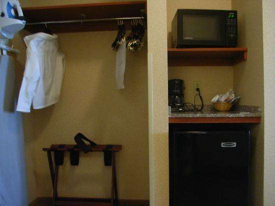Holiday Inn Express & Suites Seaside-Convention Center: Cloth hanger, microwave and mini fridge