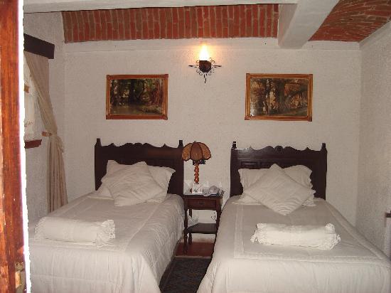 Recamara Hotel Suites Poza Real