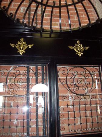 The Victor Hotel: Detail of historic bird-cage elevator