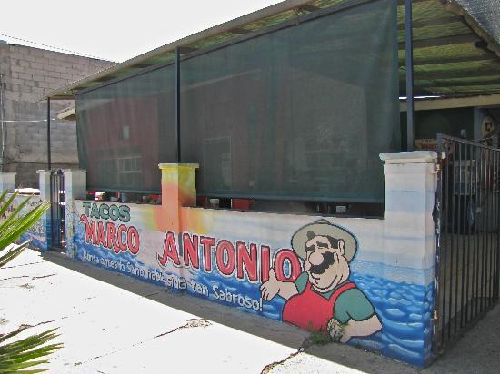 Tacos Marco Antonio : One of the covered dining areas on a quiet street.