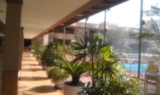 The Karnavati Club: Outside the cafe, by the pool area Karnavarti Club