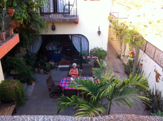 Casa Tuscany Inn: looking down from outside our room to the lovely courtyard where we were served breakfast
