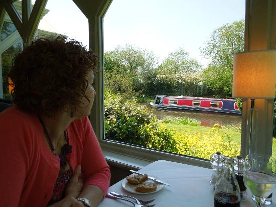 Orangery Restaurant: Window table view of passing boat on canal