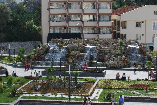 Marmaris 19 May Youth Square : Stone waterfall with bronze mermaid and cactus garden