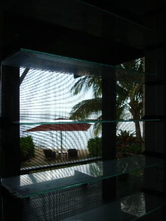 Nukubati Private Island: Our beach area thru bure window.....