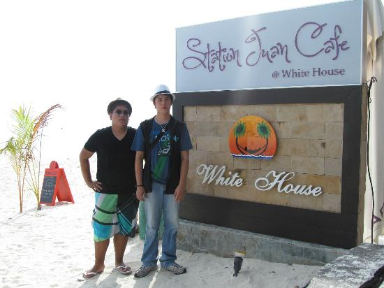 White House Beach Resort: my sons by the beach front of the resort