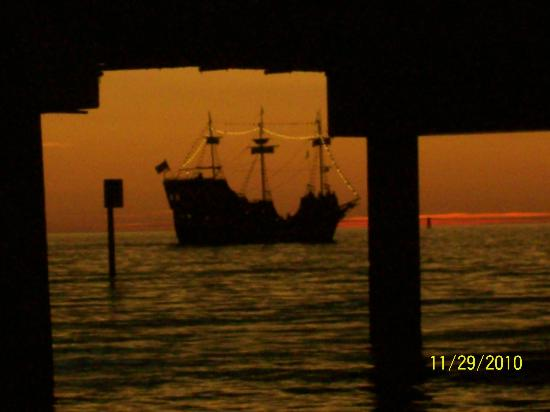 "SUNSET AT PIER 60, with the ""Pirate Ship"" in the background that you can take a ""tour"" in which"