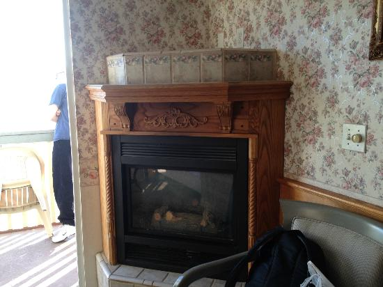 Inn on the Beach: electric fireplace by the door to patio