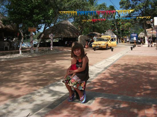 Hotel Oso Perezoso: Our daughter on Taganga's main street/boardwalk in front of the bahia