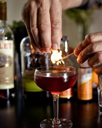Plate Shop: flaming lemon peel for cocktail
