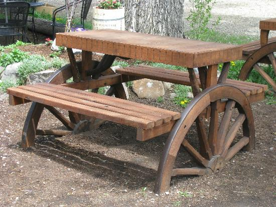 Jackson Hole Roasters - Restaurant & Coffeehouse: Wagon Wheel Benches for Outside Dinning