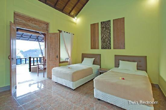 Puri Rama Homestay: slaapkamer met balkon