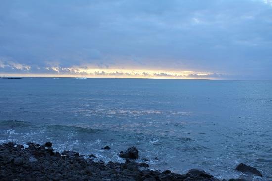 Floreana Lava Lodge: A view of the sea, at sunset, from the Golondrina Cabin.