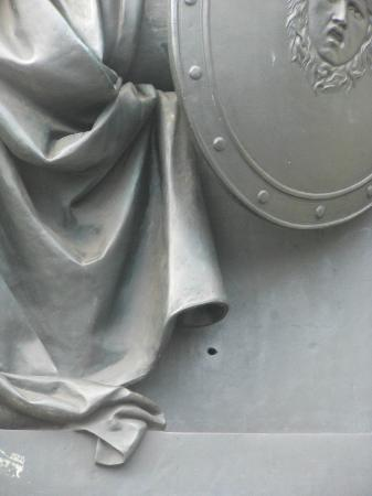 1916 Rebellion Walking Tour: One of several bullet holes from 1916 remaining in the statue of Daniel O'Connell