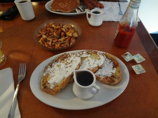 Lighthouse Cafe: fries are hard; French Toast drowning in sugar, look at that little thing of syrup