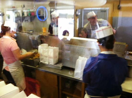 Val's Rapid SVC : A kitchen run by only four people, each with their singe assignment-grill, fry, mix and serve.