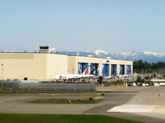 Future of Flight Aviation Center & Boeing Tour: A distant view of the enormous Boeing factory across the airfield