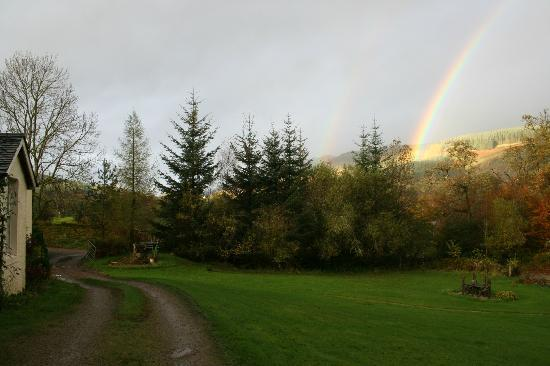 Claonairigh House: The track leading round the house, with a beautiful rainbow on the morning we departed.