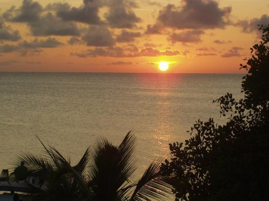 Iguana Reef Inn: Sunset as seen from our room at Iguana Inn