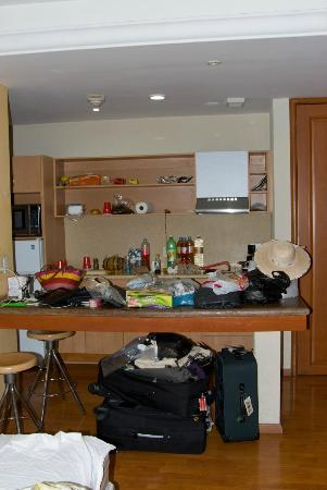 Aurea Hotel and Suites: Kitchen Area (covered in luggage)