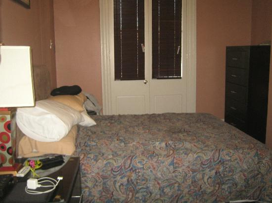 The Saint Philip Hotel: One of the 2 bedrooms with doors going out to the balcony