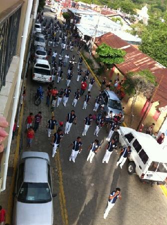 La Estacion: parade from balcony