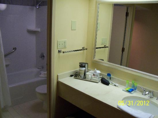 Radisson Hotel Valley Forge: sink and coffee in room, shower and toilet in small area