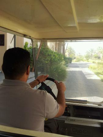 Al Areen Palace & Spa: on golf cart heading to have our breakfast