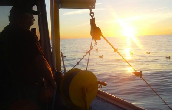 Aiden's Deep Sea Fishing: Sunset over the water, North Rustico