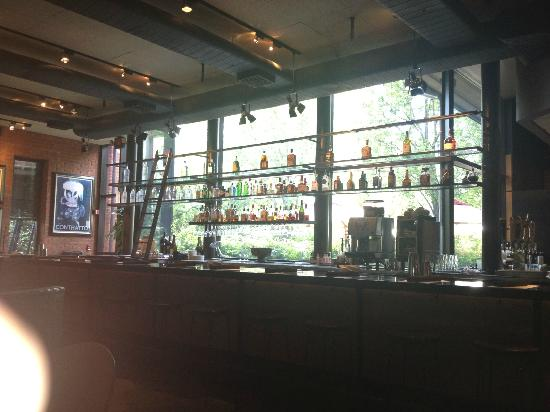Green Valley Grill: The bar is very attractive, and well lit with the large window area behind it.