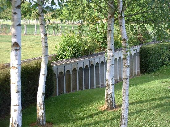 Iden Coach House : Garden with model railway bridge