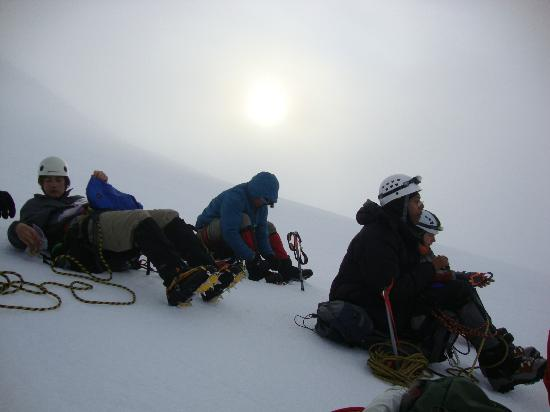 Get In The Wild Adventures : Sun peaking out at 7am as we have a snack, 3.5 hrs into the climb at this point.