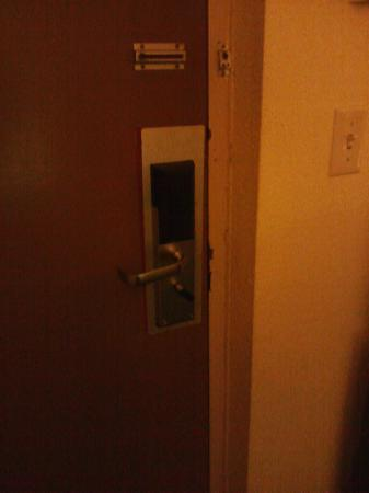 Rodeway Inn: Door lock/latch and frame strike should be repaired/replaced