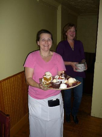 Cab's Wine Bar Bistro: Server Sheila (left) and Lisa Ayllon bring in a birthday dessert platter.