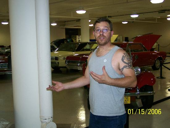 Crawford Auto-Aviation Museum: my husband explaining some things:)