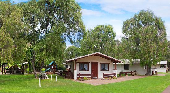 Sandy Bay Holiday Park Swiss Chalet and play ground