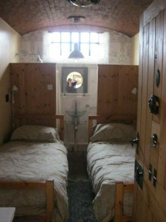 The Old Court: Two can sleep in this cell. The bathroom is behind the beds in the back.